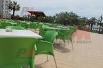 Пластмасов зелен стол, за открити пространства