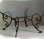 Градински маса произведен от ковано желязо