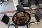 Мебели маси и столове от тъмен ратан