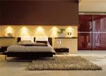 Спалня по поръчка - съчетание на текстилна тапицерия и лакирано дърво