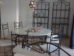 Столове и маса от ковано желязо за Вашата градина