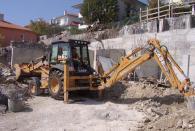 Изкопаване на земя с багер