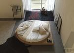 вътрешен интериор на спалня с кръгло легло